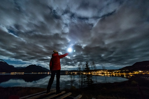 Woman with torch near Tromso in autumn, Arctic Norwayの写真素材 [FYI03566652]