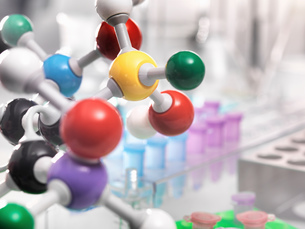 A molecular model of a chemical formula with laboratory equipment in the backgroundの写真素材 [FYI03566783]