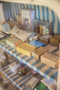 Vintage soap bars on display cupboard in handmade soap workshopの写真素材 [FYI03566919]