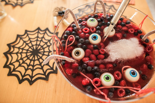 Halloween dessert with berries and floating eyeballs, close-upの写真素材 [FYI03567569]
