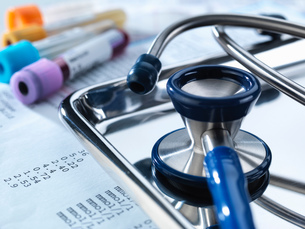 Stethoscope sitting on a tray with test results and patient specimensの写真素材 [FYI03567581]