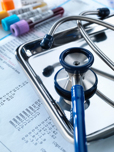 Stethoscope sitting on a tray with test results and patient specimensの写真素材 [FYI03567582]