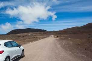 Volcanic landscape with car parked at roadside, Reunion National Park, Reunion Islandの写真素材 [FYI03568572]