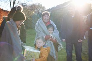Family at birthday celebration in gardenの写真素材 [FYI03569115]