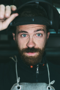 Portrait of male metalworker holding up welding maskの写真素材 [FYI03569139]