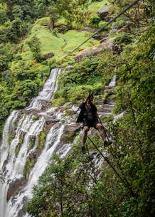 Man on zip wire in forest, Ban Nongluang, Champassak province, Paksong, Laosの写真素材 [FYI03571790]
