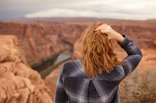 Woman standing, looking at view, rear view, Page, Arizona, USAの写真素材 [FYI03572114]