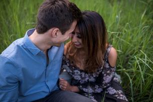 Happy couple on grass fieldの写真素材 [FYI03572566]