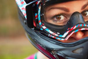 Close up portrait of female BMX rider in crash helmetの写真素材 [FYI03575084]