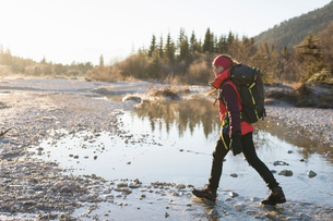 Female hiker hiking along lakeside in Bavarian Alpsの写真素材 [FYI03575874]