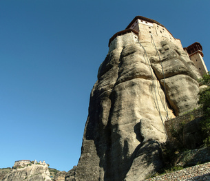 Low angle view of Roussanou Monastery on top of rock formation, Meteora, Thassaly, Greeceの写真素材 [FYI03575998]