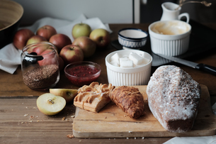 Cake and desert ingredients with apples on kitchen tableの写真素材 [FYI03576172]
