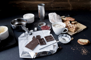Apple strudel, chocolate, cake and ingredients on kitchen tableの写真素材 [FYI03576173]
