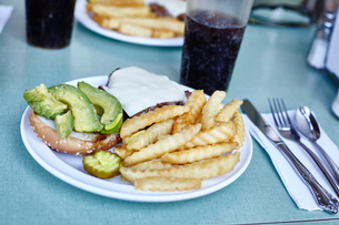 Burger and chips with cola on cafe table, New York City, USAの写真素材 [FYI03576350]