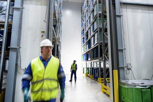 Worker with oil barrels in storage in oil blending factoryの写真素材 [FYI03577007]