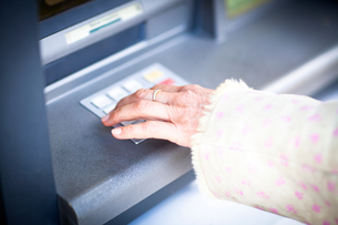 Hand of woman pressing keyboard at local french cash machineの写真素材 [FYI03577951]