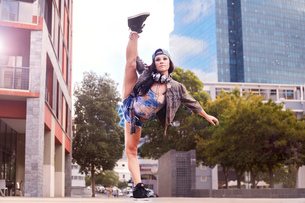Dancer kicking and balancing on one leg, Cape Town, South Africaの写真素材 [FYI03578385]