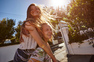 Teenage girls having fun in residential street, Cape Town, South Africaの写真素材 [FYI03578768]