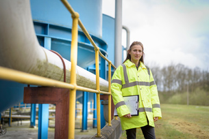 Portrait of female ecologist with waste water plant of car factoryの写真素材 [FYI03580046]