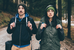 Portrait of hiking couple wearing knit hats in forest, Monte San Primo, Italyの写真素材 [FYI03581105]