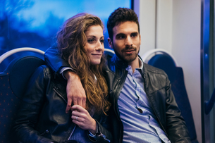 Couple travelling in train, Florence, Italyの写真素材 [FYI03581463]