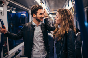 Couple travelling in train, Florence, Italyの写真素材 [FYI03581469]