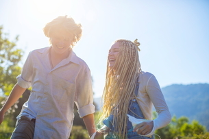 Young couple laughing in sunlight, Majorca, Spainの写真素材 [FYI03581911]