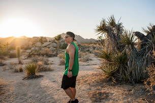 Young man in Joshua Tree National Park at sunset, California, USAの写真素材 [FYI03582285]