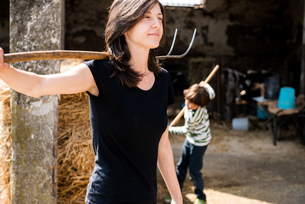 Female organic farmer with pitch fork over her shoulder on dairy farmの写真素材 [FYI03582767]