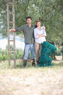 Farmer and his wife in olive yardの写真素材 [FYI03583047]