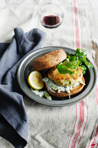 Trout tzatziki burger on plateの写真素材 [FYI03584101]
