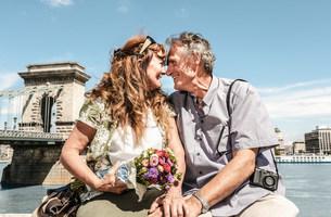 Older couple touching noses on bridgeの写真素材 [FYI03584277]