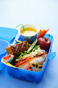 Close up of healthy food in lunch boxの写真素材 [FYI03584332]