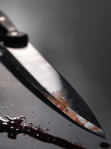 Close up of bloody knifeの写真素材 [FYI03584637]
