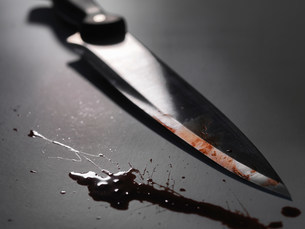 Close up of bloody knifeの写真素材 [FYI03584638]
