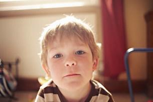 Close up of boy's curious faceの写真素材 [FYI03585134]