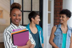 Student holding folders on campusの写真素材 [FYI03585281]