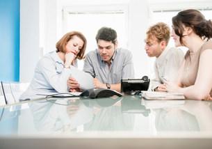 Office colleagues in meetingの写真素材 [FYI03586015]