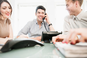 Colleagues in meeting, man on telephoneの写真素材 [FYI03586019]