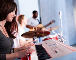 Band practising in recording studioの写真素材 [FYI03586043]