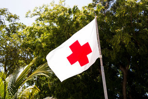 Red cross flag, help point, Labadee, Haitiの写真素材 [FYI03586378]