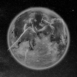 Man carrying woman within transparent planet earthの写真素材 [FYI03588592]