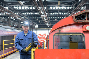 Locomotive engineer working in train worksの写真素材 [FYI03589669]