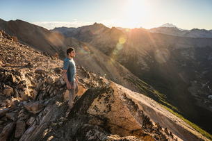 Male mountaineer looking out from top of mountain range, Nahuel Huapi National Park, Rio Negro, Argeの写真素材 [FYI03590178]