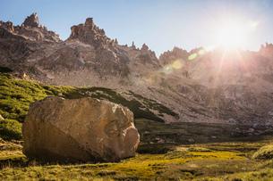 Boulder in sunlit mountain valley, Nahuel Huapi National Park, Rio Negro, Argentinaの写真素材 [FYI03590186]