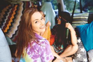 Portrait of young boho women in recreational vanの写真素材 [FYI03591213]