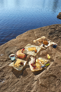 Selection of cheeses, arranged on rock, beside lake, Colgate Lake Wild Forest, Catskill Park, New Yoの写真素材 [FYI03591371]