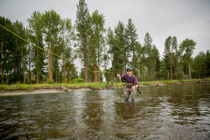 Man fishing in river, Clark Fork, Montana and Idaho, USの写真素材 [FYI03591490]