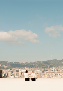 Rear view of female tourists looking out over cityscape, Barcelona, Spainの写真素材 [FYI03591926]