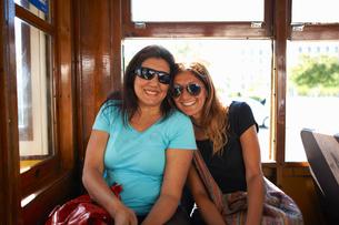 Women travelling on tram, Lisbon, Portugalの写真素材 [FYI03592029]